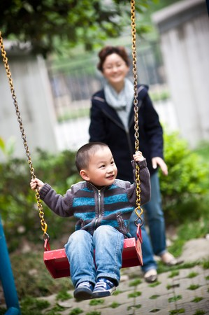 mother and son swing photo