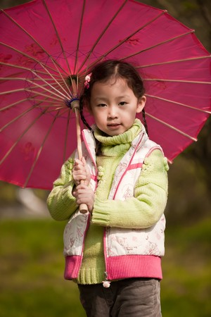 minx:  little girl with red Umbrella Stock Photo