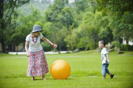 mother and son play ball in grass Stock Photo - 7720654