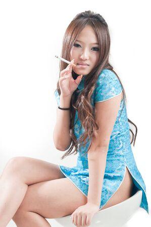 asian woman in blue Cheongsam photo