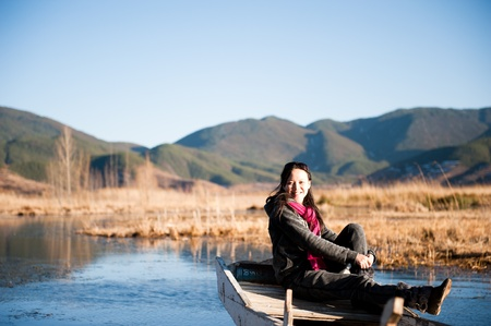 A beautiful Chinese girl, in the beautiful lake. photo