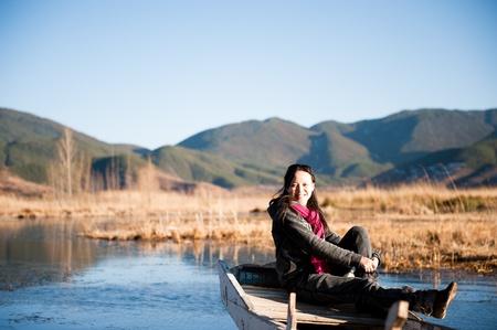 A beautiful Chinese girl, in the beautiful lake. photo