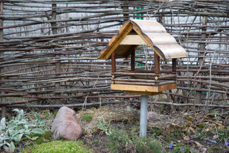 Wooden bird feeding house Stock Photo