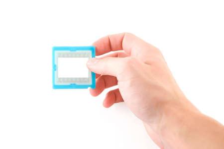 Slide frame in hand, isolated white Stock Photo