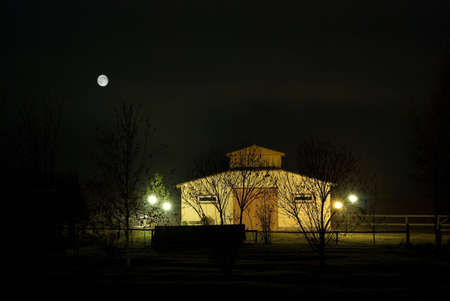 Farm stable at night, in the dark, lighted with lanterns and the moon Stock Photo - 2146806