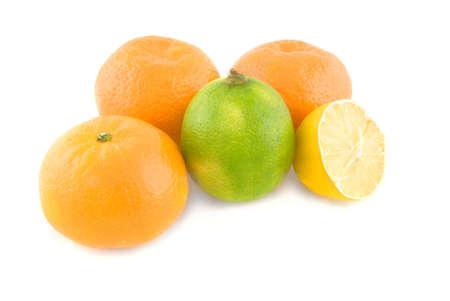 sweet segments: Fresh citrus fruits isolated on white