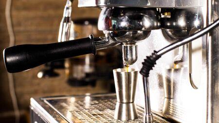 Preparing coffee on coffee machine , closeup view. Imagens