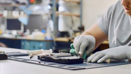 Repairman wipes processor of graphics chipset at workshop. Stok Fotoğraf