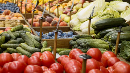 Variety fruits and vegetables on grocery store shelves