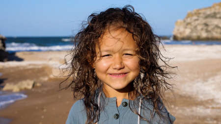 Portrait of a happy child girl at the beach.