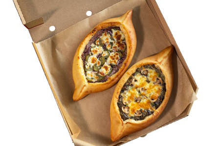 A craft box with two adjarian khachapuri, isolate. Food delivery concept.
