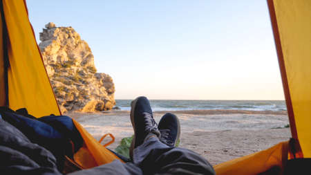 View from camping tent on sea and beautiful sandy beach 免版税图像