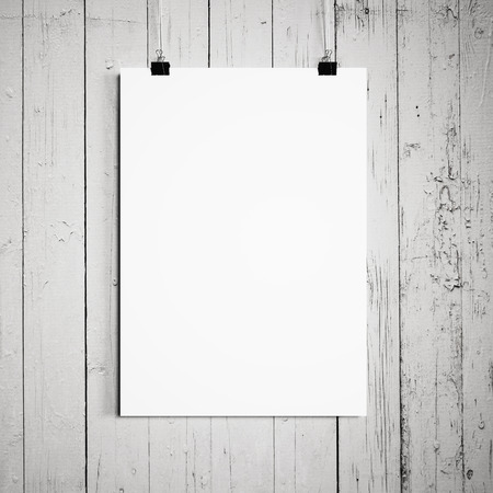 blank poster hanging on a white background a wooden wall Archivio Fotografico
