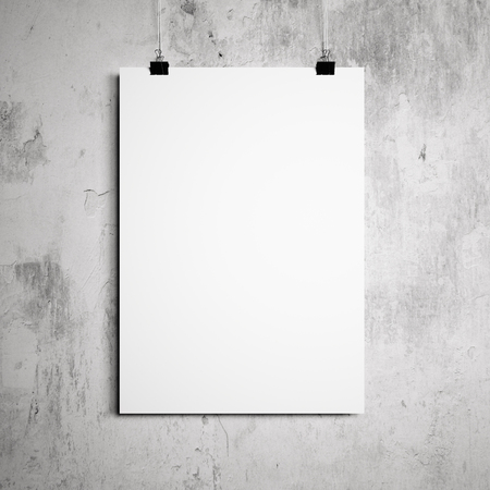 blank poster hanging on a white background painted walls