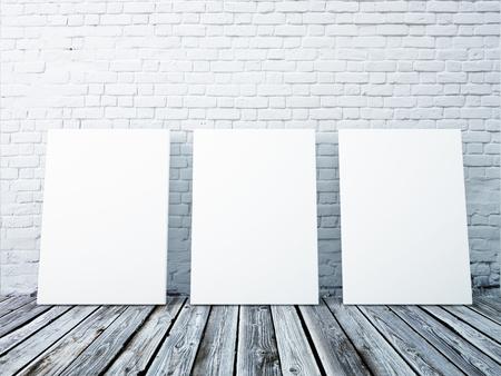 白いレンガの壁内部のポスター フレームのモックアップします。
