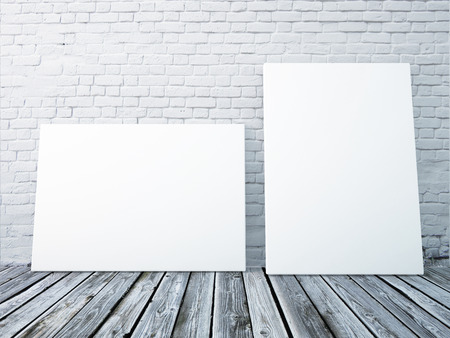 白いレンガの壁の間にポスター フレームのモックアップします。