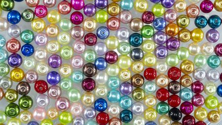 Colorful beads on a white background Stock Photo