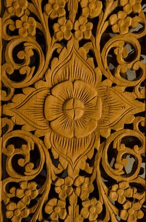 The flowers are carved from wood.
