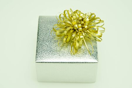 Golden bow on a gift box. Stock Photo