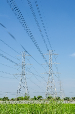 High voltage transmission lines running through the house wiring to the users in Thailand  Stock Photo