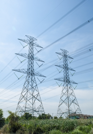 High voltage transmission lines running through the wires of the dam  To homes and factories in Thailand  Stock Photo