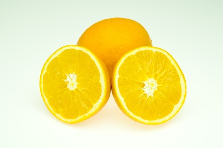 We cut two pieces of orange  To see the orange flesh  Stock Photo