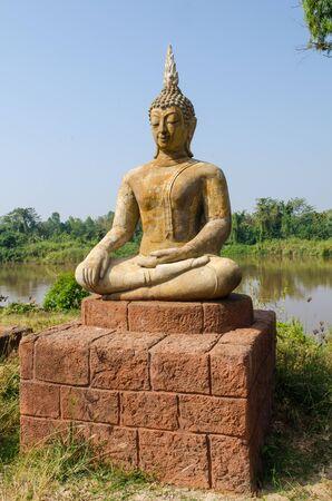 Buddha, sitting on a river in Thailand.