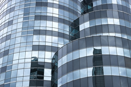 Curve modern glass facade, dark cloud reflection photo