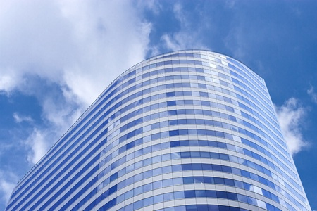 Futuristic financial building blue sky and cloud reflection photo