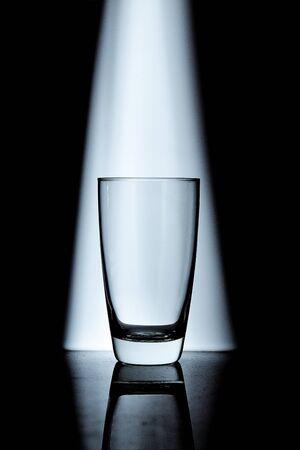 macro film: Glass on spot light scene in cool tone Stock Photo