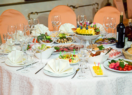 Served table for several persons in a beautiful restaurant. Dinner or party time.