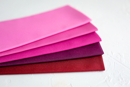A Group of red palete Fabric on white Banco de Imagens