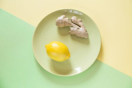 Alternative natural treatment on paper background. A fresh lemon and ginger to cure a man.