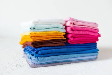 Closed up view of colorful textile on white background. Gauze or cotton samples or clothes.