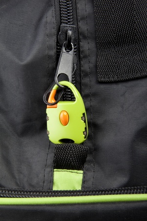 lugage: Green lock on a bags zipper