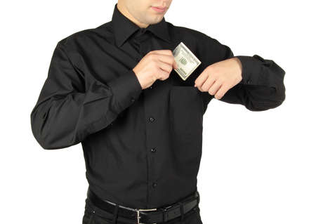 Businessman putting money in shirts pocket photo