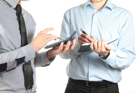 cpa: Two businessmen making calculations Stock Photo