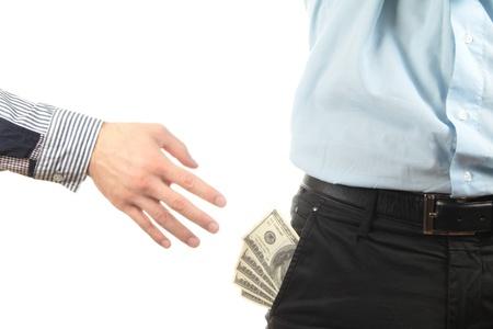 Hand taking money from pocket photo
