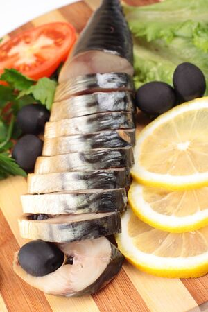 sliced herring with vegetables photo