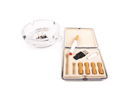 electric cigarette and a real cigarette concept isolated Stock Photo - 9047205