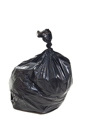 Black garbage bag isolated on white background photo