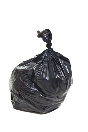 black plastic garbage bag: Black garbage bag isolated on white background