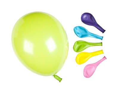 inflated: One inflated balloon with colorful balloons in the background Stock Photo