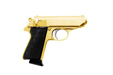 Golden revolver gun isolated on white background