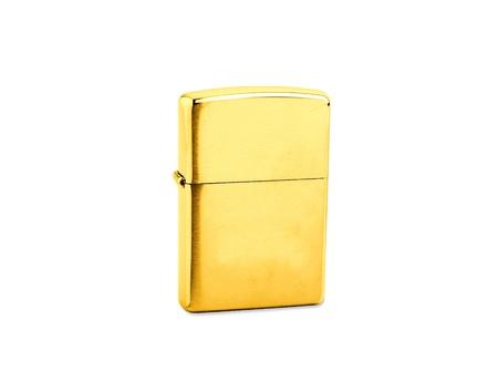 golden lighter on a white background photo