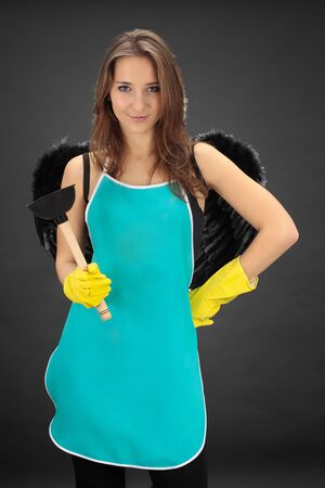 A cute maid girl cleaner with plunger Stock Photo - 10001189