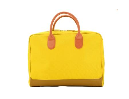 Aislar los saco amarillo sobre fondo blanco Foto de archivo