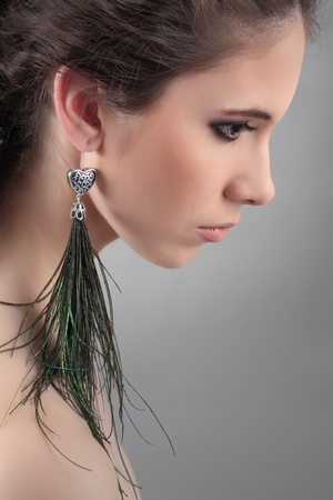profil: profil of a beautiful girls with green earrings hand made