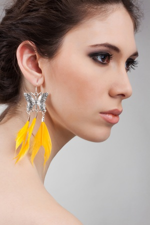 profil: profil of a beautiful girls with earrings