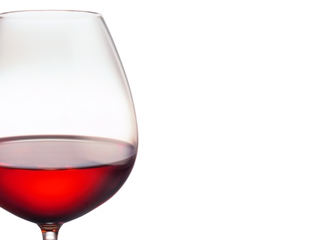 Glass of red wine on a white background photo